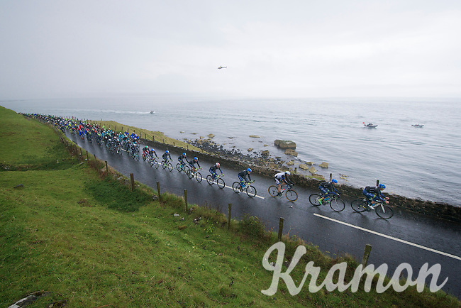 peloton followed by (pink) boats along the shores of the Irish Sea<br /> <br /> Giro d'Italia 2014<br /> stage 2: Belfast-Belfast <br /> 219km