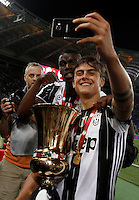 Calcio, finale Tim Cup: Milan vs Juventus. Roma, stadio Olimpico, 21 maggio 2016.<br /> Juventus' Paul Pogba, left, and Paulo Dybala take a selfie with the trophy at the end of the Italian Cup final football match between AC Milan and Juventus at Rome's Olympic stadium, 21 May 2016. Juventus won 1-0 in the extra time.<br /> UPDATE IMAGES PRESS/Isabella Bonotto