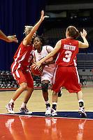 SAN ANTONIO , TX - DECEMBER 7, 2009: The University of Houston  Cougars vs. The University of Texas At San Antonio Roadrunners Women's Basketball at the Alamodome. (Photo by Jeff Huehn)