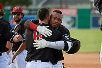 Batavia Muckdogs Albert Guaimaro (13) hugs Igor Baez (6) after a walk off single during a NY-Penn League game against the Auburn Doubledays on June 19, 2019 at Dwyer Stadium in Batavia, New York.  Batavia defeated Auburn 5-4 in eleven innings in the completion of a game originally started on June 15th that was postponed due to inclement weather.  (Mike Janes/Four Seam Images)