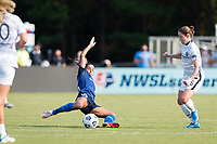 CARY, NC - SEPTEMBER 12: Debinha #10 of the NC Courage goes to ground to keep the ball from Meghan Klingenberg #25 of the Portland Thorns during a game between Portland Thorns FC and North Carolina Courage at WakeMed Soccer Park on September 12, 2021 in Cary, North Carolina.