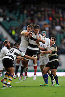 Pablo Matera of Barbarians tussles with Jon Fisher of England during the match between England and Barbarians at Twickenham Stadium on Sunday 31st May 2015 (Photo by Rob Munro)