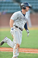 Pulaski Yankees left fielder Nathan Mikolas (33) runs to first during a game against the Greeneville Astros on July 11, 2015 in Greeneville, Tennessee. The Yankees defeated the Astros 9-3. (Tony Farlow/Four Seam Images)