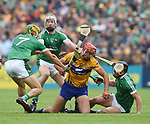 Peter Duggan of Clare in action against Dan Morrissey, Cian Lynch and Darragh O Donovan of Limerick during their Munster championship game in Ennis. Photograph by John Kelly.