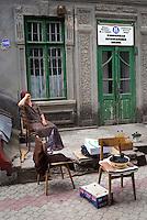 REPUBLIC OF MOLDOVA, Gagauzia, Comrat, 2009/06/26..A saleswoman of sunflower seeds in the center of Comrat, the capital of Gagauzia, in front of the music school. Pensioners often live with less than 50 EUR per month. Small businesses have developed well throughout Moldova..© Bruno Cogez / Est&Ost Photography..REPUBLIQUE MOLDAVE, Gagaouzie, Comrat, 26/06/2009..Une vendeuse de graines de tournesol dans le centre de Comrat, la capitale de la Gagaouzie, devant l'école de musique. Les retraités vivent souvent avec moins de 50EUR par mois. Les petits métiers se sont ainsi développés dans toute la Moldavie..© Bruno Cogez / Est&Ost Photography