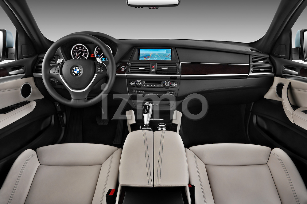 Straight dashboard view of a 2010 BMW Active Hybrid X6.