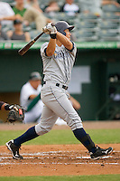 Kyeong Kang #23 of the Charlotte Stone Crabs follows through on his swing against the Jupiter Hammerheads at Roger Dean Stadium June 15, 2010, in Jupiter, Florida.  Photo by Brian Westerholt /  Seam Images