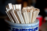 Disposable chopsticks in a restaurant. China.