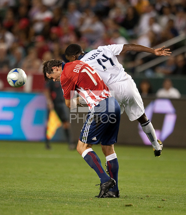 Bobby Burling (left) tries to head the ball ahead of Edson Buddle (right). The LA Galaxy defeated Chivas USA 1-0 at Home Depot Center stadium in Carson, California Saturday evening July 11, 2009.
