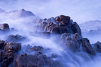 Waves roll over the rocks in Banderas Bay near Puerto Vallarta, Mexico.