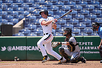 Cincinnati Bearcats Paul Komistek (32) hits a home run during a game against the UCF Knights on May 25, 2021 at BayCare Ballpark in Clearwater, Florida.  UCF defeated Cincinnati 14-10 in game one of the American Athletic Conference Tournament.  Catching is Josh Crouch (44).  (Mike Janes/Four Seam Images)