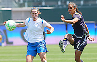 Shannon Boxx #7 of the Los Angeles Sol makes a pass against the defense of Kelly Schmedes #3 of the Boston Breakers during thier WPS game at Home Depot Center on May 10, 2009 in Carson, California.