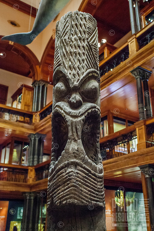 A wood carving of the Hawaiian deity Kane on display at the Bishop Museum, Honolulu, O'ahu.