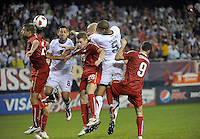US defender Oguchi Onyewu (5) heads in the USA's second goal.  The U.S. Men's National Team tied Poland 2-2 at Soldier Field in Chicago, IL on October 9, 2010.