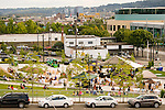 Families enjoying a concert at the Oregon Convention Center park in summer.