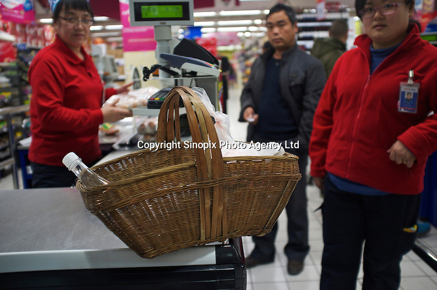 A basket containing a turtles Tesco, in the Fengtai area of Beijing.  Live turtles are sold and often killed on the premises of the shop.  The turtles cost 48 RMB (4.88 UK pounds) for a kilo. The turtle in the basket cost 163 RMB (16.59 UK pounds).<br /> <br /> Photo by Sinopix