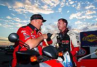 Nov 1, 2020; Las Vegas, Nevada, USA; NHRA top fuel driver Steve Torrence (right) with pro stock owner Richard Freeman during the NHRA Finals at The Strip at Las Vegas Motor Speedway. Mandatory Credit: Mark J. Rebilas-USA TODAY Sports