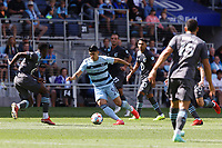 ST. PAUL, MN - AUGUST 21: Alan Pulido #9 of Sporting Kansas City in traffic during a game between Sporting Kansas City and Minnesota United FC at Allianz Field on August 21, 2021 in St. Paul, Minnesota.