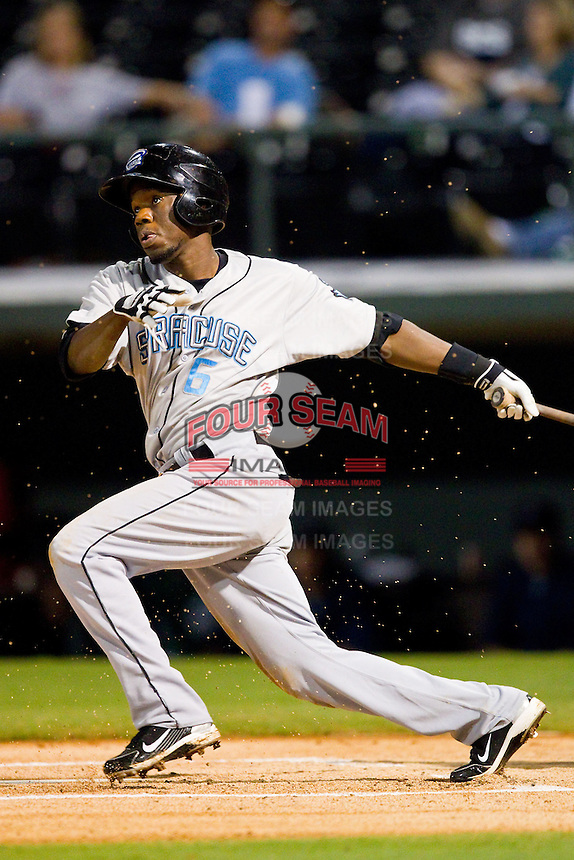 Eury Perez (6) of the Syracuse Chiefs follows through on his swing against the Charlotte Knights at Knights Stadium on August 29, 2012 in Fort Mill, South Carolina.  (Brian Westerholt/Four Seam Images)