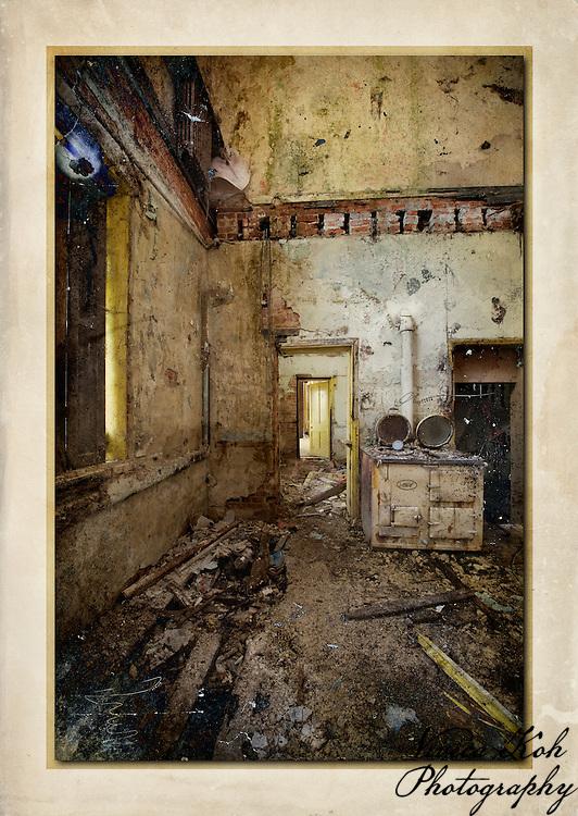 Kitchen with doorways in derelict manor house