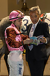 Jockey Umberto Rispoli (L) and trainer Gary Ng Ting-Keung (R) talk in the parade ring before the East Point Handicap on 29 March 2017, at Happy Valley Racecourse  in Hong Kong, China. Photo by Chris Wong / Power Sport Images