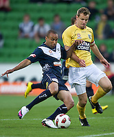 MELBOURNE, AUSTRALIA - NOVEMBER 18: Archie Thompson of the Victory and Alex Wilkinson of the Mariners in action during the round 14 A-League match between the Melbourne Victory and Central Coast Mariners at AAMI Park on November 18, 2010 in Melbourne, Australia (Photo by Sydney Low / Asterisk Images)