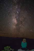 A stargazer enjoys the Milky Way on a dark night at Grand Canyon National Park, Arizona