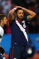 Clint Dempsey of USA stands dejected during game against Slovenia