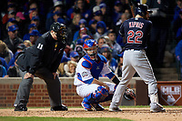Chicago Cubs catcher David Ross (3) checks the runner in between umpire Tony Randazzo and batter Jason Kipnis (22) in the sixth inning during Game 5 of the Major League Baseball World Series against the Cleveland Indians on October 30, 2016 at Wrigley Field in Chicago, Illinois.  (Mike Janes/Four Seam Images)