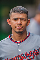 9 June 2013: Minnesota Twins infielder Eduardo Escobar stands in the dugout during a game against the Washington Nationals at Nationals Park in Washington, DC. The Nationals shut out the Twins 7-0 in the first game of their day/night double-header. Mandatory Credit: Ed Wolfstein Photo *** RAW (NEF) Image File Available ***