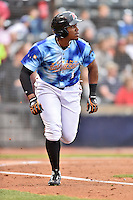Richmond Flying Squirrels right fielder Carlos Moncrief (1) runs to first during a game against the Hartford Yard Goats at The Diamond on April 30, 2016 in Richmond, Virginia. The Yard Goats defeated the Flying Squirrels 5-1. (Tony Farlow/Four Seam Images)