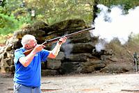 Pat Brain of Fayetteville shoots his double-barrel black-powder shotgun.<br />(NWA Democrat-Gazette/Flip Putthoff)