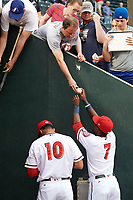 Harrisburg Senators Juan Soto (10) and Daniel Johnson (7) sign autographs for fans before a game against the New Hampshire Fisher Cats on May 12, 2018 at FNB Field in Harrisburg, Pennsylvania.  The game was postponed due to weather.  (Mike Janes/Four Seam Images)