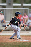 Miami Marlins left fielder Kyle Barrett (85) follows through on a swing during a minor league Spring Training game against the New York Mets on March 26, 2017 at the Roger Dean Stadium Complex in Jupiter, Florida.  (Mike Janes/Four Seam Images)