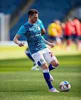 24th April 2021; Ewood Park, Blackburn, Lancashire, England; English Football League Championship Football, Blackburn Rovers versus Huddersfield Town;  Corry Evans of Blackburn Rovers warms up pre match