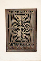 A metal grate designed in the Art Deco period famous in Miami is displayed at the Wolfsonian Museum .1001 Washington Avenue.Miami Beach, FL 33139-5017.(305) 535-2623.The Wolfsonian-FIU is a Florida International University museum devoted to late-19th and early-20th century design. Located in the historic Art Deco district of Miami Beach, Florida, the Wolfsonian was founded by Mitchell Wolfson, Jr. in 1986 to display and preserve his personal art collection.  He donated the collection and its building to Florida International University in 1997.<br />  The museum's exhibits occupy 3 floors of a renovated 7-story warehouse (56,000 square feet), with its workshops, offices, and library occupying the remaining space.The collections feature furniture and decorative arts, paintings and sculpture, books, prints, and posters that reflect social, political and technological changes between 1885 and 1945. Artifacts are primarily of North American and European origin.