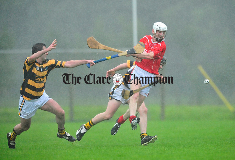 Corofin's Dara Shannon under pressure from the Tubber defense. Photograph by Declan Monaghan
