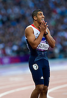 05 AUG 2012 - LONDON, GBR - Adam Gemili (GBR) of Great Britain recovers after his men's 100m semi final during the London 2012 Olympic Games athletics in the Olympic Stadium at the Olympic Park in Stratford, London, Great Britain (PHOTO (C) 2012 NIGEL FARROW)