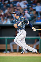 Jacksonville Jumbo Shrimp third baseman Brian Schales (13) follows through on a swing during a game against the Mobile BayBears on April 14, 2018 at Baseball Grounds of Jacksonville in Jacksonville, Florida.  Mobile defeated Jacksonville 13-3.  (Mike Janes/Four Seam Images)