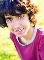 Casual teen male with beautiful brown eyes in summer sun