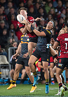 George Bridge takes a high ball under pressure from Jonah Lowe  during the 2021 Super Rugby Aotearoa final between the Crusaders and Chiefs at Orangetheory Stadium in Christchurch, New Zealand on Saturday, 8 May 2021. Photo: Joe Johnson / lintottphoto.co.nz