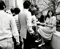 Arlene Perly Rae is backed into a quiet corner as husband and New Democratic Party leade Bob Rae holds a press conference outside the Toronto Stock Exchange. Rae said the federal dividend tax credit costs the province about $200 million<br /> <br /> 1985<br /> <br /> PHOTO :  Erin Comb - Toronto Star Archives - AQP