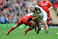 Joe Marler of Harlequins is tackled by Schalk Brits of Saracens during the Aviva Premiership match between Saracens and Harlequins at Wembley Stadium on Saturday 31st March 2012 (Photo by Rob Munro)