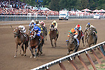Golden Ticket(3) with orange cap and Alpha(6) in blue cap lead the field in the drive to the wire in the 2012 Travers Stakes(G1). Saratoga Race Course, Saratoga Springs, New York. 08-25-2012.  Arron Haggart/Eclipse Sportswire