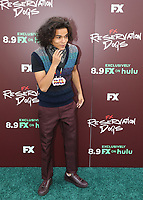 """TULSA, OK - AUGUST 2: D'Pharaoh Woon-A-Tai attends the Red Carpet Event for the Series Premiere of FX's """"Reservation Dogs"""" at Circle Cinema on August 2, 2021 in Tulsa, Oklahoma. (Photo by Tom Gilbert/FX/PictureGroup)"""