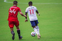ORLANDO, FL - APRIL 24: Omar Gonzálex #44 of Toronto FC and Cristián Dájome #11 of Vancouver Whitecaps battle for the ball during a game between Vancouver Whitecaps and Toronto FC at Exploria Stadium on April 24, 2021 in Orlando, Florida.