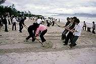 Danang, February 1988. Community work on the beach of Danang.