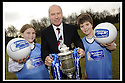 24/02/2009  Copyright Pic: James Stewart.File Name : sct_jspa01_scottis_cup.FORMER FALKIRK LEGEND ALEX TOTTEN SHOWS OFF THE HOMECOMING SCOTLAND SCOTTISH CUP TO SARAH JOHNSTON AND IAN MCARTHUR, PRIMARY SEVEN PUPILS AT ST MARGARET'S PRIMARY SCHOOL, POLMONT......Press Release..... A unique interactive tour to engage primary school children with football and the Homecoming Scottish Cup rolls into town today, Tuesday 24 February 2009 at St Margaret's Primary School in Falkirk.  . .Up to 100 pupils in primaries 5 to 7 at each local school will receive specialist skills and drill training from Scottish Football Association coaches as well as getting the chance to view the Homecoming Scottish Cup trophy itself.. .The school tour takes the form of a giant 'football-shaped' tent, which houses the world's oldest footballing trophy and information about Homecoming Scotland and the Scottish Cup tournament.. .Future football stars will be given soccer skills training ahead of watching their home team, Falkirk, take on Inverness Caledonian Thistle in the quarter finals of the Homecoming Scottish Cup on the weekend of 7 March.. .Falkirk legend Alex Totten, who used to manage the side, will be on hand at St Margaret's Primary School to share his knowledge and experience with the kids and to see the trophy himself.. .All primary schools in Scotland will also be sent education packs to encourage pupils to know more about Homecoming Scotland and to learn more about healthy eating, fitness and playing football as a way to keep fit and have fun.  . .As part of the football celebrations, the tour will then encourage locals in the town centre to get behind their local team, when the cup visits The Mall in Falkirk later in the afternoon.. .The Homecoming Scottish Cup Tour has been designed to engage with Scotland's local communities and spread the message about joining in the celebrations for Homecoming Scotland 2009, a programme comprising over 300 events to celebrate Scotland's culture, h