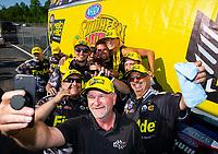 May 6, 2018; Commerce, GA, USA; NHRA top fuel driver Leah Pritchett (back center) celebrates with crew after winning the Southern Nationals at Atlanta Dragway. Mandatory Credit: Mark J. Rebilas-USA TODAY Sports