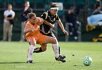 Christie Rampone (left) battles against Tiffany Weimer (right). FC Gold Pride defeated Sky Blue FC 1-0 at Buck Shaw Stadium in Santa Clara, California on May 3, 2009.